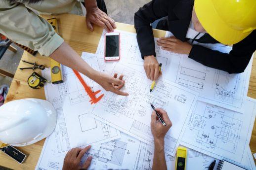 engineer people meeting working pointing drawings
